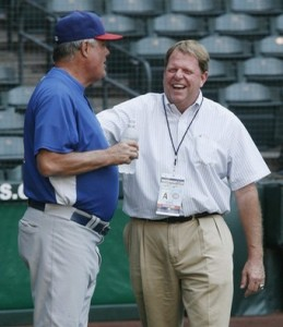 The Chicago Cubs General Manager Hendry laughs with manager Piniella during the team's workout at Chase Field in Phoenix